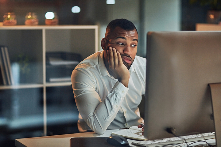 Man Waiting for Computer to Load Screen