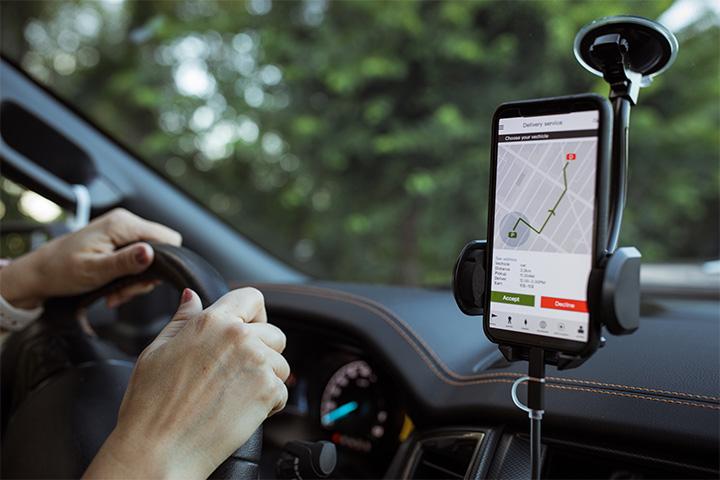 driving-car-and-navigating-gps-on-phone