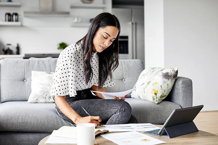 woman paying internet fees in livingroom