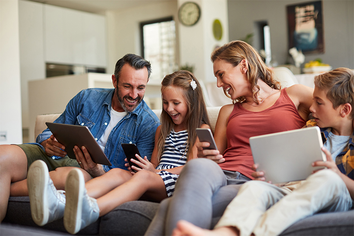 a family using the internet to connect to multiple devices