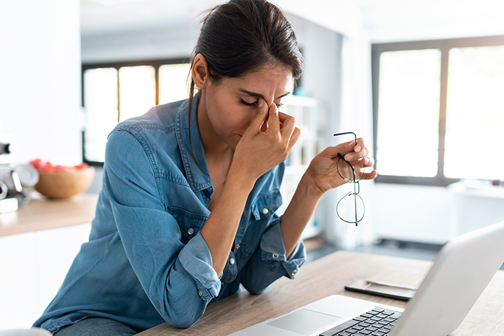 A women frustrated by her slow internet at her computer